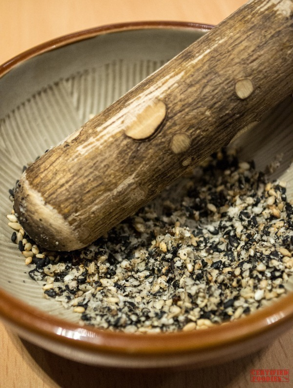The Yabu ritual includes grinding these roasted sesame seeds