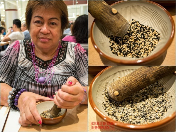 The Yabu ritual of grinding, crushing roasted sesame seeds for the katsu sauce