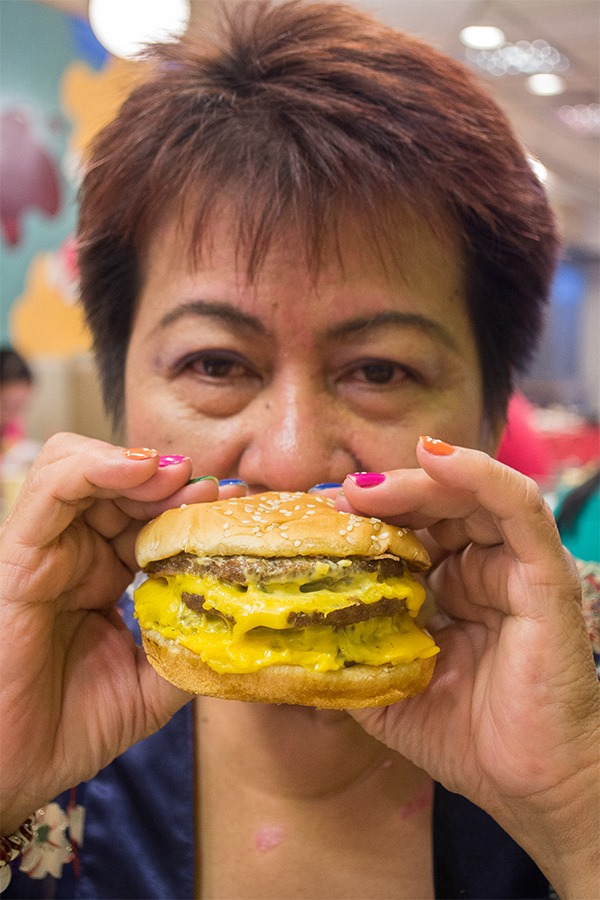 Our nanay taking on the Burger King BK Stack for the King