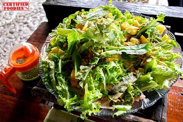 Vegetarian Salad with nuts, mangoes and pesto dressing