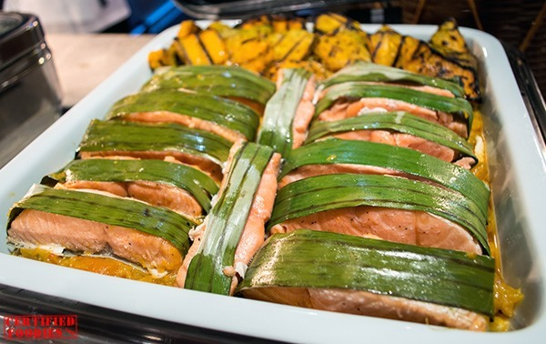 Banana Wrapped Baked Salmon with Kalabasa Gata at Corniche of Diamond Hotel
