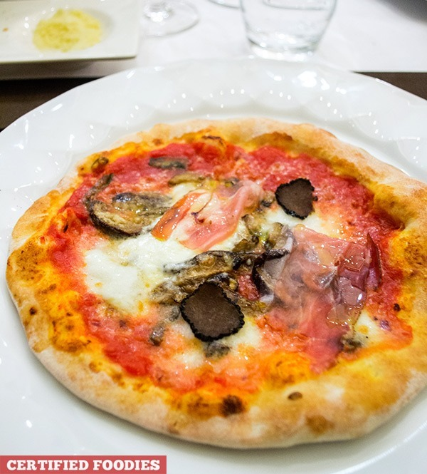 Truffle pizzetta with prosciutto, porcini mushrooms, and imported buffalo cheese