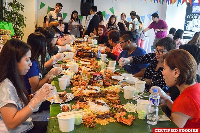 Amy Perez and our friends enjoying the boodle fight spread