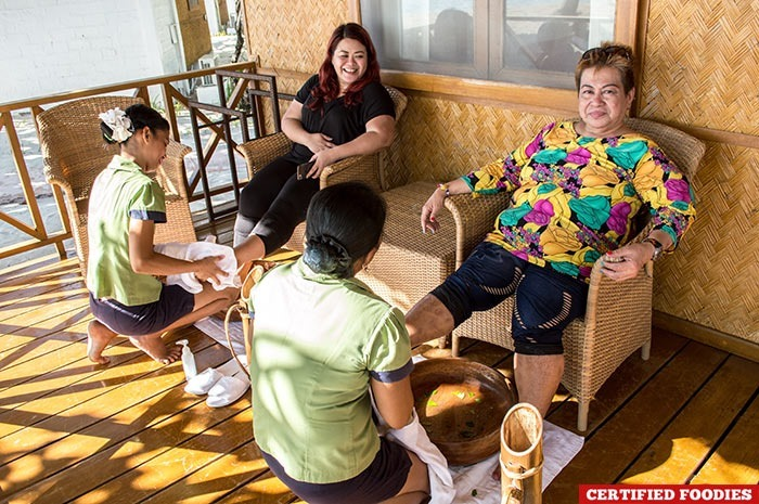 Nanay and I enjoying our complimentary foot wash with calamansi at Club Paradise Resort